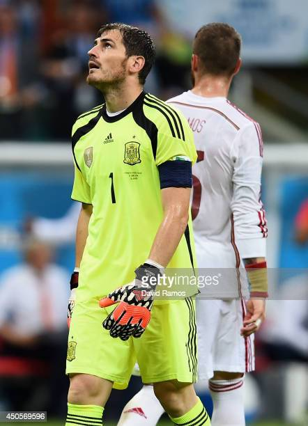 Iker Casillas of Spain reacts after allowing a goal in the second half during the 2014 FIFA World Cup Brazil Group B match between Spain and...
