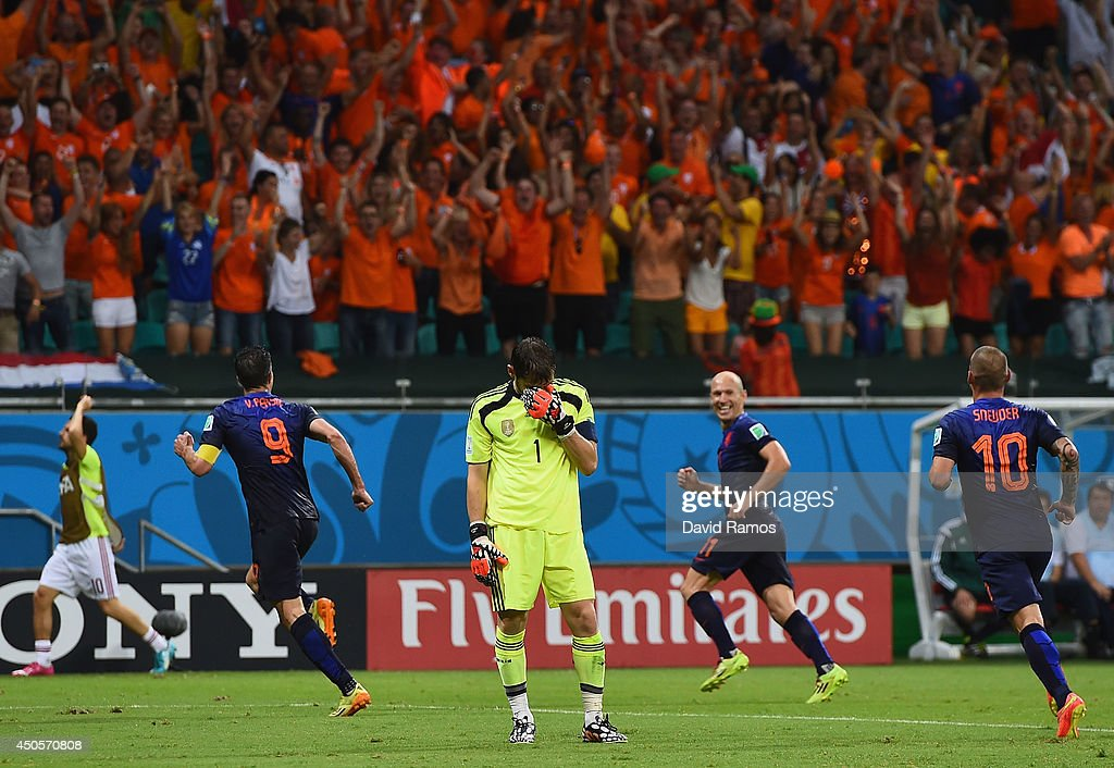 <a gi-track='captionPersonalityLinkClicked' href=/galleries/search?phrase=Iker+Casillas&family=editorial&specificpeople=215446 ng-click='$event.stopPropagation()'>Iker Casillas</a> of Spain reacts after allowing the Netherlands fourth goal to <a gi-track='captionPersonalityLinkClicked' href=/galleries/search?phrase=Robin+van+Persie&family=editorial&specificpeople=214179 ng-click='$event.stopPropagation()'>Robin van Persie</a> during the 2014 FIFA World Cup Brazil Group B match between Spain and Netherlands at Arena Fonte Nova on June 13, 2014 in Salvador, Brazil.