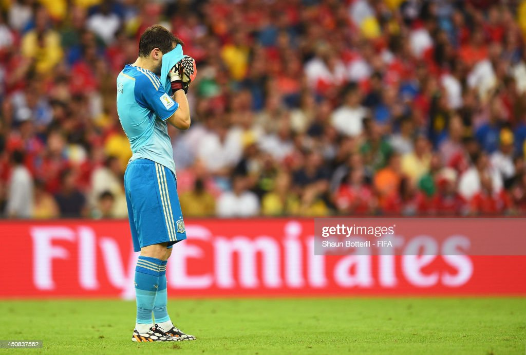 <a gi-track='captionPersonalityLinkClicked' href=/galleries/search?phrase=Iker+Casillas&family=editorial&specificpeople=215446 ng-click='$event.stopPropagation()'>Iker Casillas</a> of Spain reacts after Chile's second goal during the 2014 FIFA World Cup Brazil Group B match between Spain and Chile at Estadio Maracana on June 18, 2014 in Rio de Janeiro, Brazil.