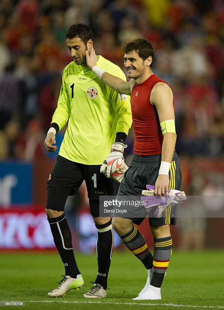 <a gi-track='captionPersonalityLinkClicked' href=/galleries/search?phrase=Iker+Casillas&family=editorial&specificpeople=215446 ng-click='$event.stopPropagation()'>Iker Casillas</a> (R) of Spain smiles with Giorgi Loira of Georgia after the FIFA 2014 World Cup Qualifier between Spain and Georgia on October 15, 2013 in Albacete, Spain. Spain won the match 2-0.