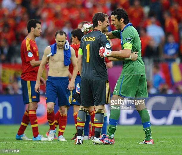 Iker Casillas of Spain speaks to Gianluigi Buffon of Italy after the UEFA EURO 2012 group C match between Spain and Italy at The Municipal Stadium on...