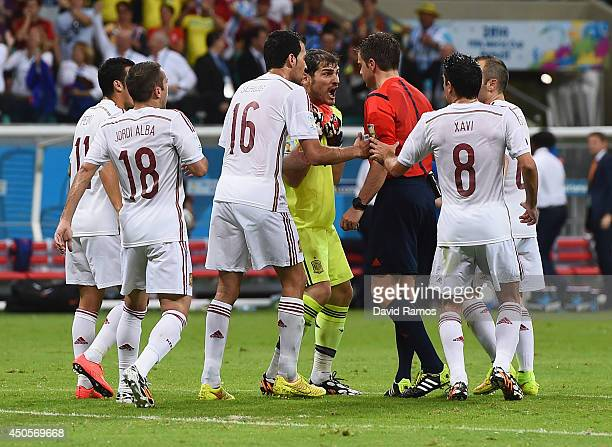 Iker Casillas of Spain yells at referee Nicola Rizzoli after a play in the second play during the 2014 FIFA World Cup Brazil Group B match between...