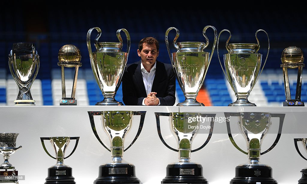 Iker Casillas poses behind trophies he has won during his career in Real Madrid after holding a press conference with Real president Florentino Perez at the Santiago Bernabeu stadium to announce that he will be leaving Real Madrid football team on July 13, 2015 in Madrid, Spain.