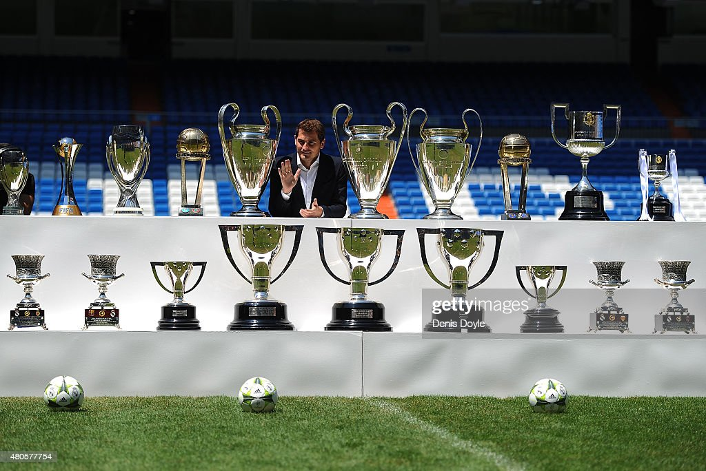 <a gi-track='captionPersonalityLinkClicked' href=/galleries/search?phrase=Iker+Casillas&family=editorial&specificpeople=215446 ng-click='$event.stopPropagation()'>Iker Casillas</a> poses behind trophies he has won during his career in Real Madrid after holding a press conference with Real president Florentino Perez at the Santiago Bernabeu stadium to announce that he will be leaving Real Madrid football team on July 13, 2015 in Madrid, Spain.