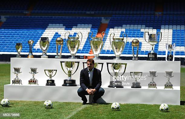Iker Casillas poses in front of trophies he has won during his career in Real Madrid after holding a press conference with Real president Florentino...