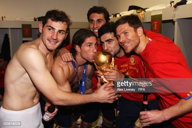 Iker Casillas Sergio Ramos Alvaro Arbeloa Raul Albiol and Xabi Alonso of Spain pose with the trophy in the Spanish dressing room after they won the...