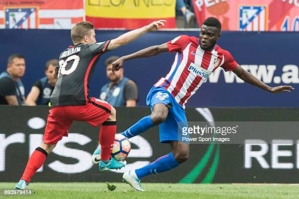 Iker Muniain Goni of Athletic Club competes for the ball with Thomas Teye Partey of Atletico de Madrid during the La Liga match between Atletico de...