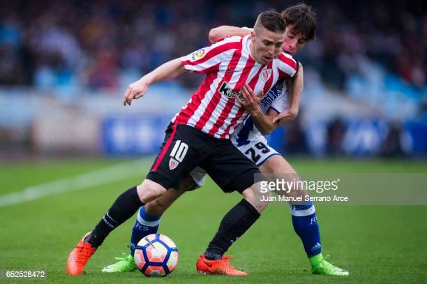 Iker Muniain of Athletic Club Bilbao duels for the ball with Alvaro Odriozola of Real Sociedad during the La Liga match between Real Sociedad de...