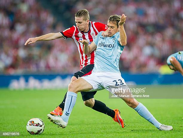Iker Muniain of Athletic Club duels for the ball with Javier Lara of SD Eibar during the La Liga match between Athletic Club and SD Eibar at San...