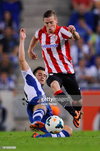 Iker Muniain of Athletic Club duels for the ball with Luis Pizzi of RCD Espanyol during the La Liga match between RCD Espanyol and Athletic Club at...