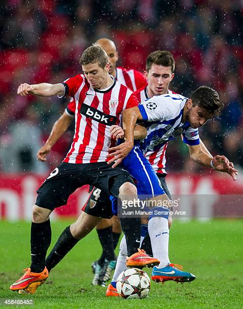 Iker Muniain of Athletic Club duels for the ball with Ruben Neves of FC Porto during the UEFA Champions League Group H match between Athletic Club...