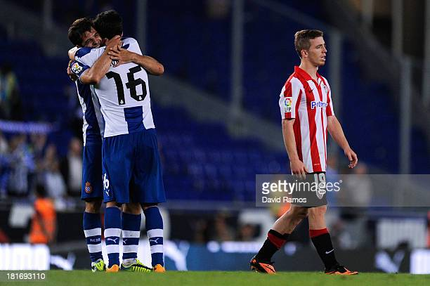 Iker Muniain of Athletic Club leaves the pitch dejected after being defeated as Victor Sanchez of RCD Espanyol and his teammate Javi Lopez of RCD...