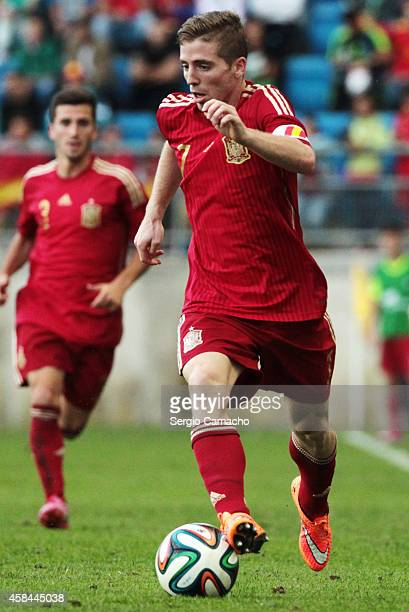 Iker Muniain of Spain runs with the ball during the UEFA European Under21 Championship playoff second leg match between Spain and Serbia at the...