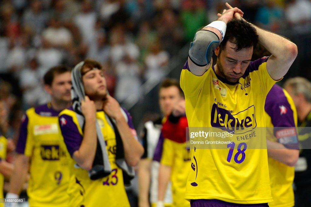 <a gi-track='captionPersonalityLinkClicked' href=/galleries/search?phrase=Iker+Romero&family=editorial&specificpeople=853946 ng-click='$event.stopPropagation()'>Iker Romero</a> Fernandez of Berlin looks dejected after the EHF Final Four semi final match between Fuechse Berlin and THW Kiel at Lanxess Arena on May 26, 2012 in Cologne, Germany.