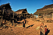 Iko children outside their thatched houses on stilts in the remote village of Phouyair a three day walk from Muang Sing in Northern Laos The ethnic...