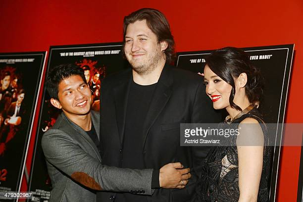 Iko Uwais director Gareth Evans and Julie Estelle attend 'The Raid 2' special screening at Sunshine Landmark on March 17 2014 in New York City