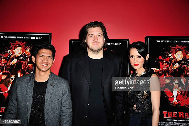 Iko Uwais Gareth Evans and Julie Estelle attend 'The Raid 2' special screening at Sunshine Landmark on March 17 2014 in New York City