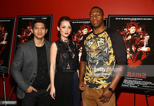 Iko Uwais Julie Estelle and Wayne Barrett attend 'The Raid 2' special screening at Sunshine Landmark on March 17 2014 in New York City