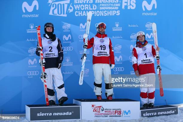 Ikuma Horishima of Japan wins the gold medal Benjamin Cavet of France wins the silver medal Mikael Kingsbury of Canada wins the bronze medal during...