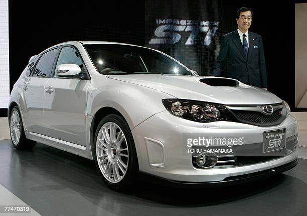 Ikuo Mori president of Japan's Fuji Heavy Industries known for its Subaru brand presents the world debut of the flagship vehicle 'Impreza WRX STI' at...