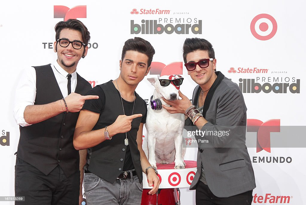 Il Volo celebrates with Bullseye, Target's Beloved Bull Terrier Mascot, at the 2013 Billboard Latin Music Awards at BankUnited Center on April 25, 2013 in Miami, Florida.