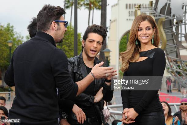 Il Volo sing to Maria Menounos at 'Extra' at Universal Studios Hollywood on November 20 2013 in Los Angeles California