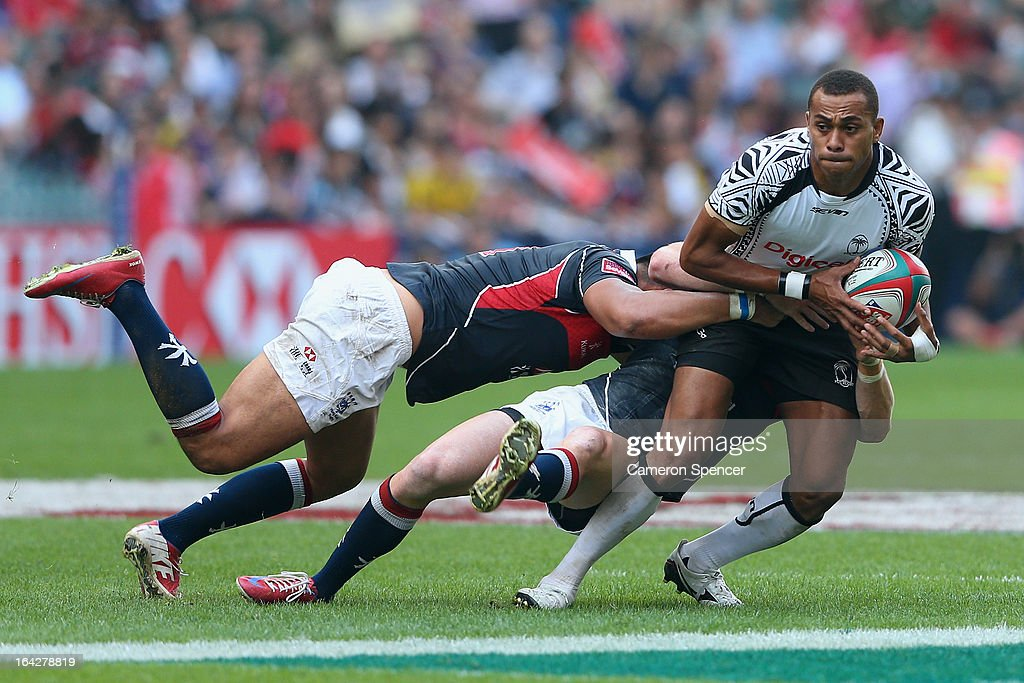 Ilai Tinai of Fiji is tackled during the Pool D match between Fiji and Hong Kong during day one of the 2013 Hong Kong Sevens at Hong Kong Stadium on...