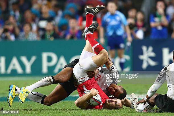 Ilai Tinai of Fiji tackles Lee Williams of Wales during the cup final match between Fiji and Wales during day three of the 2013 Hong Kong Sevens at...