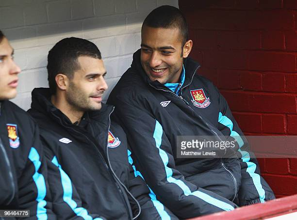 Ilan and Mido of West Ham United look on from the bench during the Barclays Premier League match between Burnley and West Ham United at Turf Moor on...