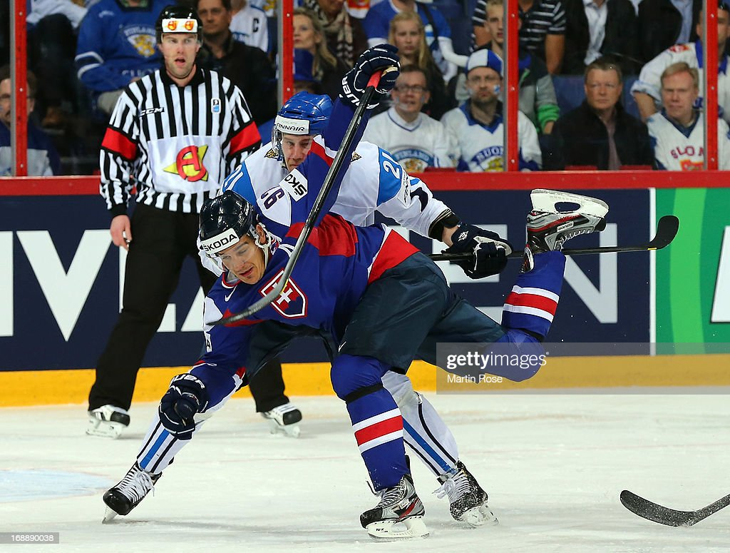 Ilari Melart(back) of Finland and Tomas Kopecky (front) of Slovakia battle for the puck during the IIHF World Championship quarterfinal match between Finland and Slovakia at Hartwall Areena on May 16, 2013 in Helsinki, Finland.