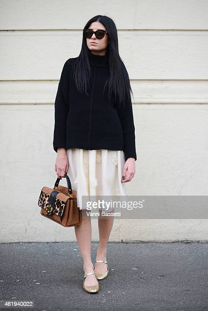 Ilaria Ginevra De Munari poses wearing a Zara top Dior skirt St Laurent shoes and Paula Cademartori bag during day 3 of Milan Menswear Fashion Week...