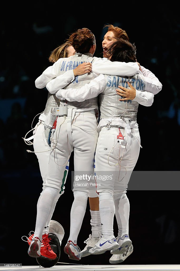 <a gi-track='captionPersonalityLinkClicked' href=/galleries/search?phrase=Ilaria+Salvatori&family=editorial&specificpeople=2326199 ng-click='$event.stopPropagation()'>Ilaria Salvatori</a>, <a gi-track='captionPersonalityLinkClicked' href=/galleries/search?phrase=Arianna+Errigo&family=editorial&specificpeople=5436672 ng-click='$event.stopPropagation()'>Arianna Errigo</a>, <a gi-track='captionPersonalityLinkClicked' href=/galleries/search?phrase=Valentina+Vezzali&family=editorial&specificpeople=772094 ng-click='$event.stopPropagation()'>Valentina Vezzali</a> and <a gi-track='captionPersonalityLinkClicked' href=/galleries/search?phrase=Elisa+Di+Francisca&family=editorial&specificpeople=2212338 ng-click='$event.stopPropagation()'>Elisa Di Francisca</a> of Italy celebrate winning gold after the Women's Foil Team Fencing gold medal match against Russia on Day 6 of the London 2012 Olympic Games at ExCeL on August 2, 2012 in London, England.