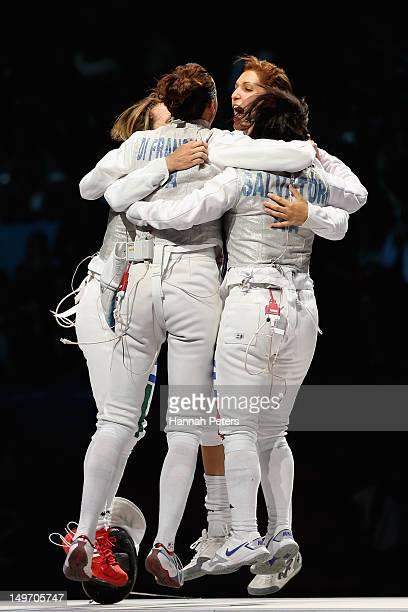 Ilaria Salvatori Arianna Errigo Valentina Vezzali and Elisa Di Francisca of Italy celebrate winning gold after the Women's Foil Team Fencing gold...