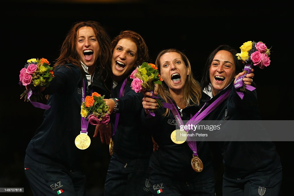 <a gi-track='captionPersonalityLinkClicked' href=/galleries/search?phrase=Ilaria+Salvatori&family=editorial&specificpeople=2326199 ng-click='$event.stopPropagation()'>Ilaria Salvatori</a>, <a gi-track='captionPersonalityLinkClicked' href=/galleries/search?phrase=Arianna+Errigo&family=editorial&specificpeople=5436672 ng-click='$event.stopPropagation()'>Arianna Errigo</a>, <a gi-track='captionPersonalityLinkClicked' href=/galleries/search?phrase=Valentina+Vezzali&family=editorial&specificpeople=772094 ng-click='$event.stopPropagation()'>Valentina Vezzali</a> and <a gi-track='captionPersonalityLinkClicked' href=/galleries/search?phrase=Elisa+Di+Francisca&family=editorial&specificpeople=2212338 ng-click='$event.stopPropagation()'>Elisa Di Francisca</a> of Italy celebrate with their gold medals during the medal ceremony after the Women's Foil Team Fencing gold medal match on Day 6 of the London 2012 Olympic Games at ExCeL on August 2, 2012 in London, England. Russia won silver and Korea won bronze.