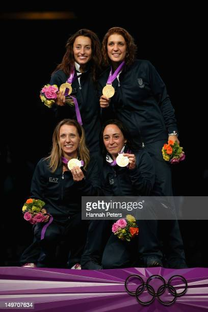 Ilaria Salvatori Arianna Errigo Valentina Vezzali and Elisa Di Francisca of Italy celebrate with their gold medals during the medal ceremony after...