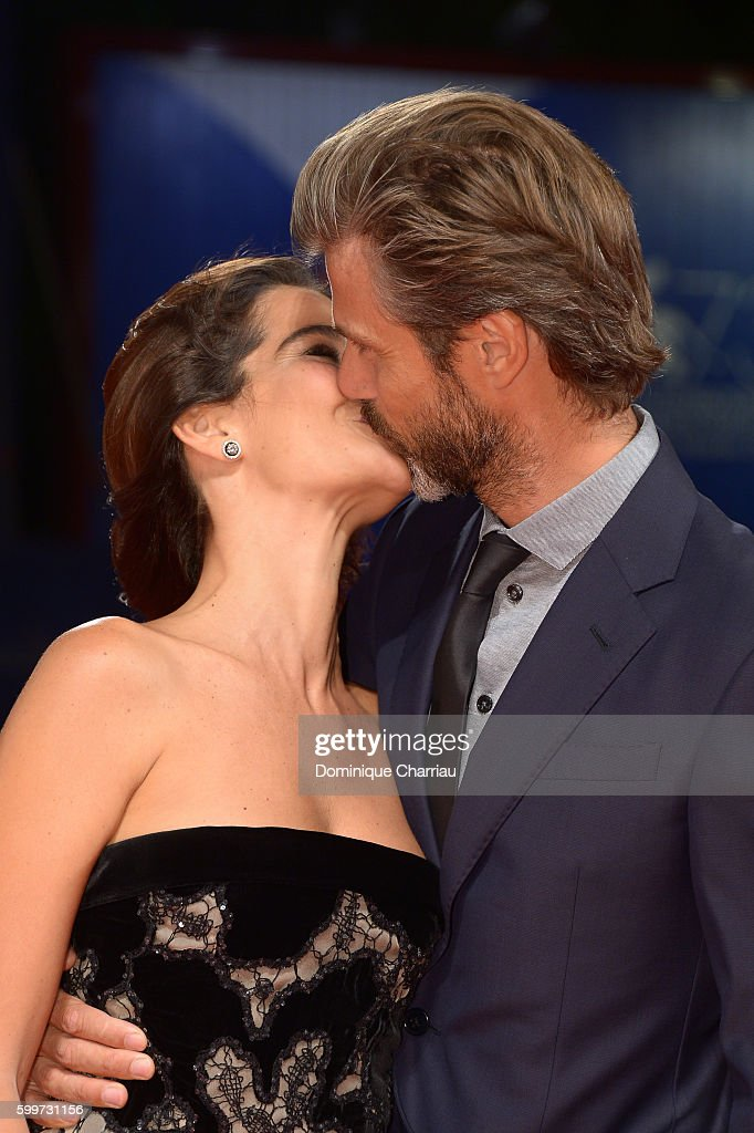 Ilaria Spada and director Kim Rossi Stuart kiss during the premiere of 'Tommaso' during the 73rd Venice Film Festival at Sala Grande on September 6, 2016 in Venice, Italy.