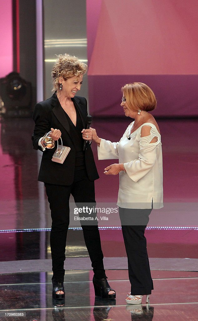 Ilaria Venturini Fendi (L) receives Bellisario award from Consolata Golfo (R) during the Premio Bellisario 2013 at Dear RAI studios on June 20, 2013 in Rome, Italy.