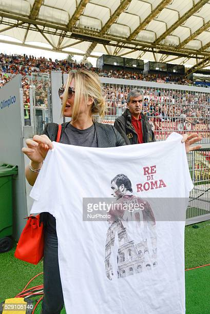 Ilary Blasi shows the tshirt dedicated to her husband Francesco Totti during the Italian Serie A football match between AS Roma and AC Chievo Verona...
