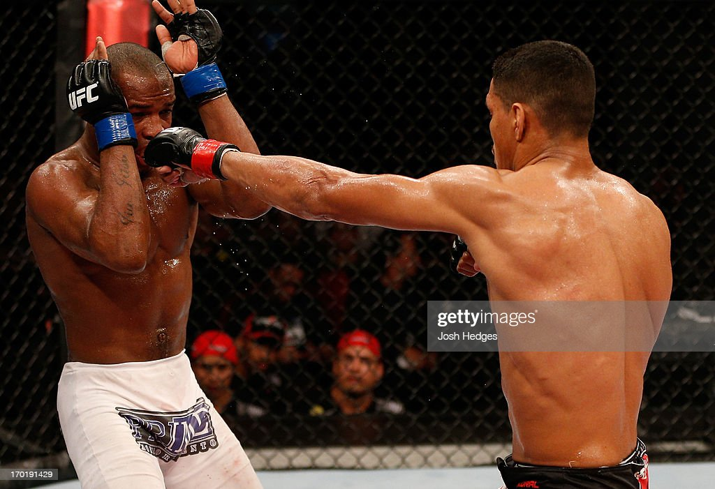 Ildemar Alcantara punches Leandro Silva in their welterweight fight during the UFC on FUEL TV event at Paulo Sarasate Arena on June 8, 2013 in Fortaleza, Ceara, Brazil.