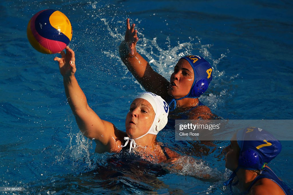Ildiko Toth of Hungary in action with captain Marina Canetti (top) and Melani Dias of Hungary during the Women's Water Polo first preliminary round match between Hungary and Brazil during Day Two of the 15th FINA World Championships at Piscines Bernat Picornell on July 21, 2013 in Barcelona, Spain.