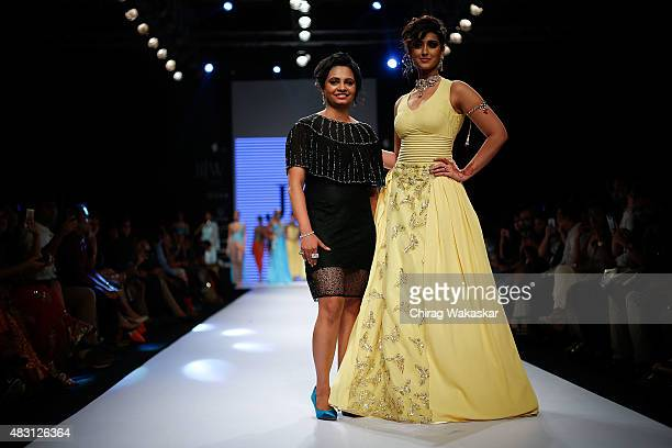 Ileana D'Cruz walks the runway with Preeti Jain at the Jewels by Preeti show during Day 4 of the India International Jewellery Week at the Grand...