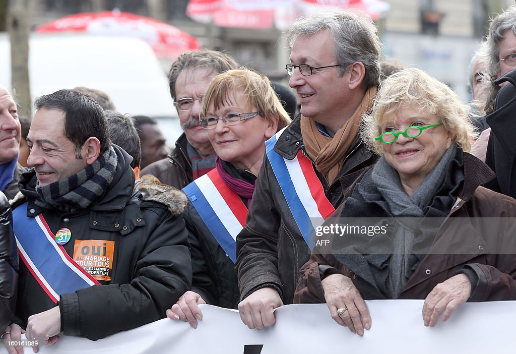 Ile-de-France regional counsellor Jean-Luc Romero, French PCF (French Communist Party) member of Parliament, Marie-George Buffet, PCF leader Pierre Laurent and former Ecologist presidential candidate Eva Joly take part in a demonstration for the legalisation of gay marriage and LGBT (lesbian, gay, bisexual, and transgender) parenting, in Paris on January 27, 2013, two days before a parliamentary debate on the government's controversial marriage equality bill, which will allow gay couples the same rights as their straight counterparts.