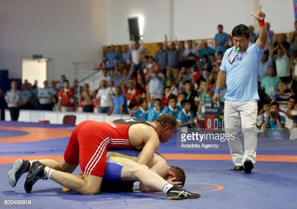 Ilhan Citak of Turkey in action against Vladislav Tarasov of Russia during men's 98 kg grecoroman wrestling within the 23rd Summer Deaflympics 2017...