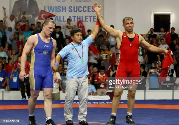 Ilhan Citak of Turkey wins against Vladislav Tarasov of Russia in men's 98 kg grecoroman wrestling within the 23rd Summer Deaflympics 2017 in Samsun...