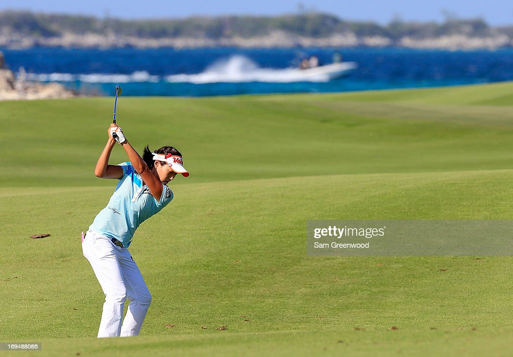 Ilhee Lee of Korea plays a shot on the 8th hole during the second round of the Pure Silk-Bahamas LPGA Classic at the Ocean Club course on May 25, 2013 in Paradise Island, Bahamas.