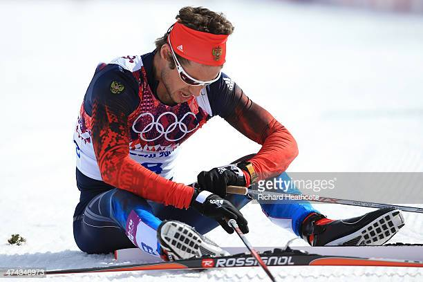 Ilia Chernousov of Russia reacts after finishing in the Men's 50 km Mass Start Free during day 16 of the Sochi 2014 Winter Olympics at Laura...