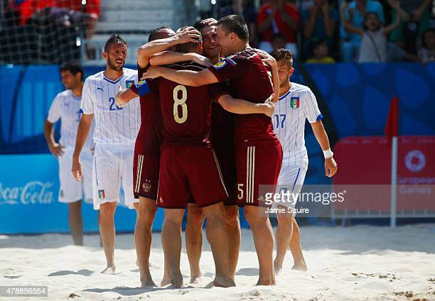 Ilia Leonov of Russia is congratulated by team mates as he scores their third goal during the Men's Beach Soccer gold medal match between Italy and...