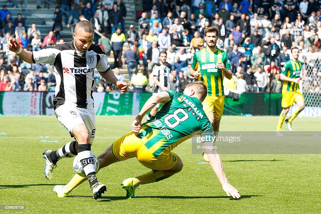 Iliass Bel Hassani of Heracles Almelo, Aaron Meijers of ADO Den Haag during the Dutch Eredivisie match between Heracles Almelo and ADO Den Haag at Polman stadium on May 01, 2016 in Almelo, The Netherlands
