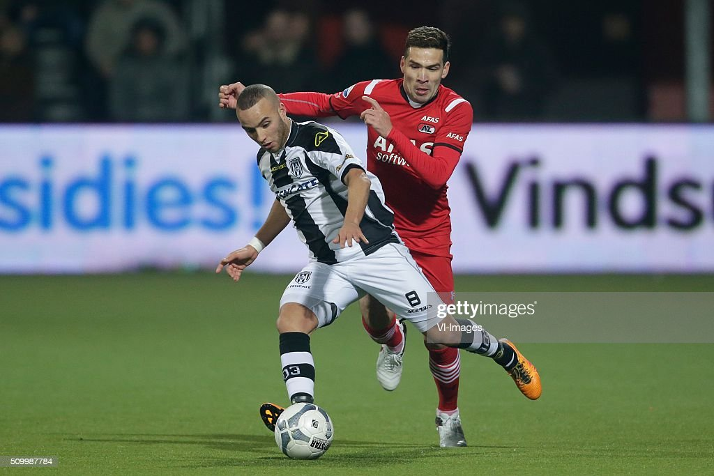 Iliass Bel Hassani of Heracles Almelo, Celso Ortiz of AZ Alkmaar during the Dutch Eredivisie match between Heracles Almelo and AZ Alkmaar at Polman stadium on February 13, 2016 in Almelo, The Netherlands