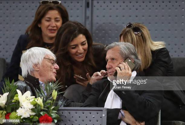 Ilie Nastase and Bernie Ecclestone watch play during day six of the Mutua Madrid Open tennis at La Caja Magica on May 11 2017 in Madrid Spain